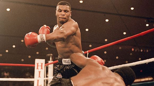 1986: Tyson demolishes Berbick to become the youngest heavyweight champ in history.