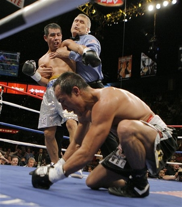 Barrera restrained by ref after nailing the downed Marquez.