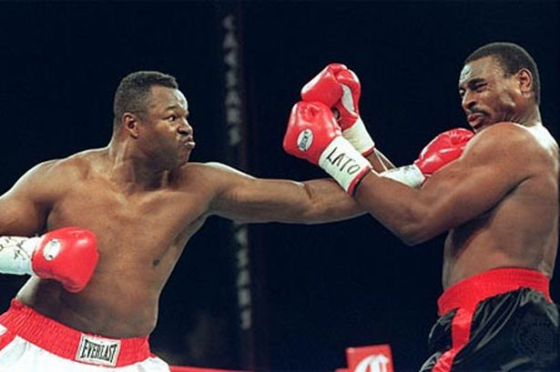 Larry Holmes pontificates in Cut Time.