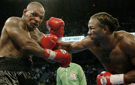 Tyson taking a beating from Lennox Lewis.