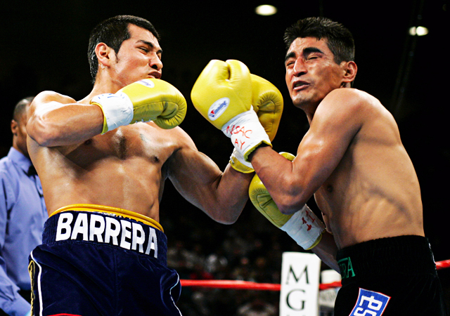 Erik Morales of Tijuana, Mexico (R) exchanges blows with Marco Antonio Barrera of Mexico City, Mexico in the first round of their WBC super featherweight championship fight at the MGM Grand Garden Arena in Las Vegas, Nevada November 27, 2004. REUTERS/Steve Marcus JSH/SH Reuters / Picture supplied by Action Images *** Local Caption *** RBBORH2004112800074.jpg