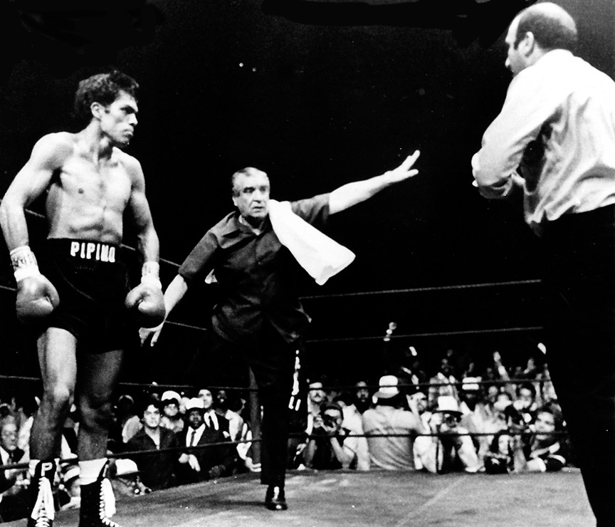 The champion's trainer stops the fight.
