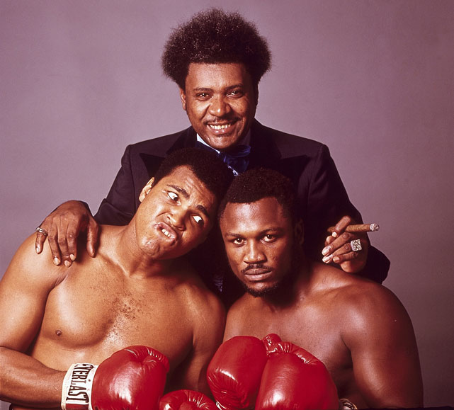 Promoter King poses with the two rivals before Fight III.
