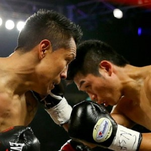 (L-R) Takashi Miura throws a right to the face of Francisco Vargas during their WBC super featherweight title fight at the Mandalay Bay Events Center on November 21, 2015 in Las Vegas, Nevada.