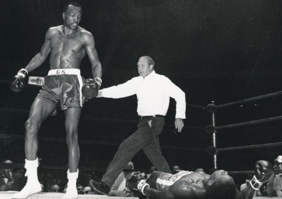 Foster stands over an unconscious Dick Tiger.