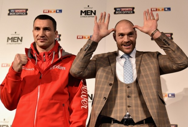 DUESSELDORF, GERMANY - NOVEMBER 24:  Tyson Fury jokes next to Wladimir Klitschko as they have their stare off during a press conference at Rheinterassen on November 24, 2015 in Duesseldorf, Germany.  (Photo by Dennis Grombkowski/Bongarts/Getty Images) ***BESTPIX***