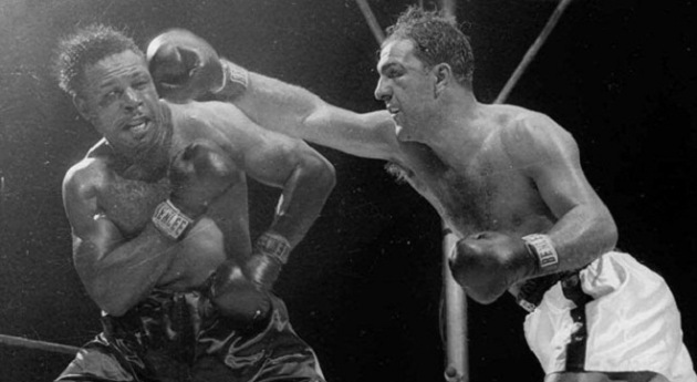 Marciano's final fight: Archie Moore falls to The Rock.