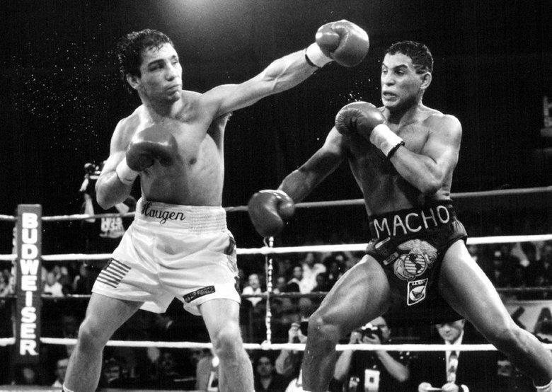 Haugen (left) battles Hector Camacho.