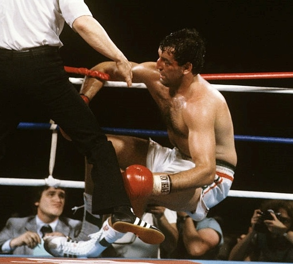 Boxing: WBC Heavyweight Title: Gerry Cooney against the ropes with referee Mills Lane during round 13 knockdown by Larry Holmes at Ceasars Palace. Las Vegas, NV 6/11/1982 CREDIT: Neil Leifer (Photo by Neil Leifer /Sports Illustrated/Getty Images) (Set Number: TC35591 )