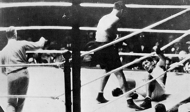 Tunney hits the canvas.