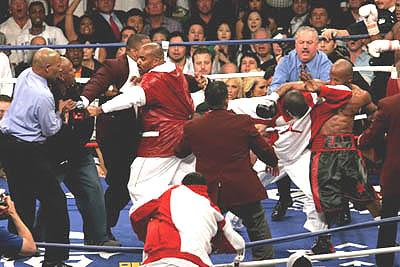 Chaos after Roger Mayweather enters the ring.