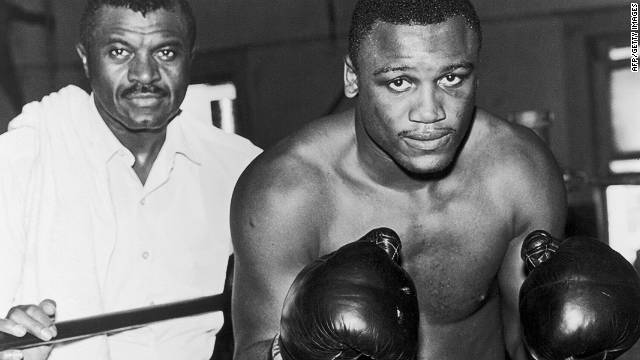 A pair of legends: a young Frazier with his trainer, Eddie Futch.