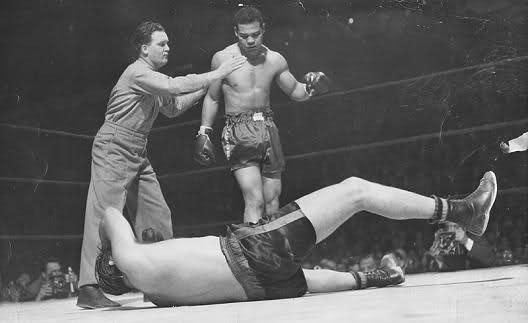 "Joe Louis stands over 6'7"" Buddy Baer: giant sized heavyweights are nothing new."