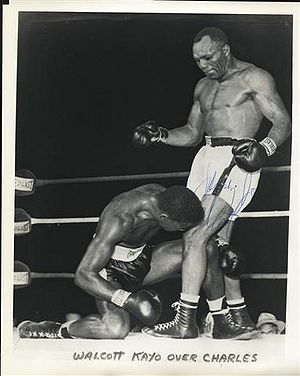 Charles sinks to the canvas after absorbing Walcott's big left hook.