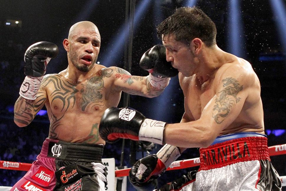 Cotto batters Maravilla.