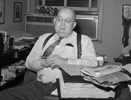 A. J. Liebling Sitting at Desk