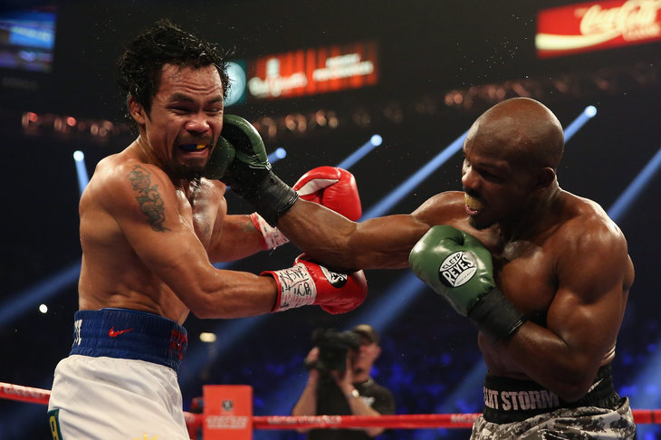 Bradley mixes it up with Pacquiao.