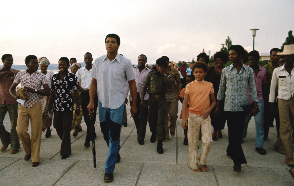 Ali Walking with Entourage and Friends