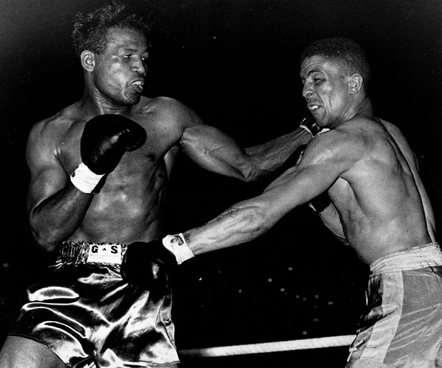 Robinson (left) nails Randy Turpin.