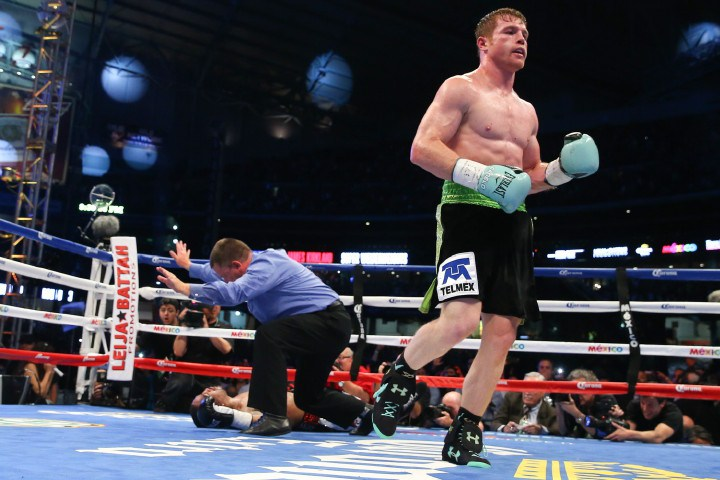 "HOUSTON, TX - MAY 9: Saul ""Canelo"" Alvarez (black/green trunks) knocks out James Kirkland (black/red trunks) in the 3rd round of their 12 round super welterweight fight at Minute Maid Park on May  9, 2015 in Houston, Texas. (Photo by Ed Mulholland/Golden Boy/Golden Boy via Getty Images) *** Local Caption ***Saul Alvarez; James Kirkland"
