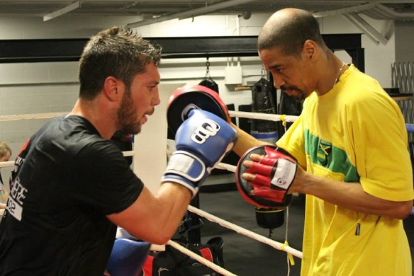 Francis Lafreniere working the mitts with Howard Grant. Photo by Manny Montreal.