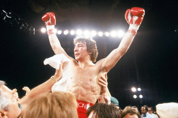 "LAS VEGAS - MAY 8: Ray ""Boom Boom"" Mancini raises his hands in victory after defeating Arturo Frias in the WBA Lightweight Title match at the Aladdin Hotel on May 8, 1982 in Las Vegas, Nevada. (Photo by Andy Hayt/Getty Images) ** TCN OUT **"