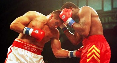 In the rematch, Golota again lost by DQ for repeated belts to the balls.