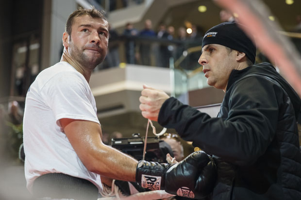 s tied by his trainer Stéphan Larouche, right, during a public training session at Complexe Desjardins in Montreal on Monday, January 13, 2014. Bute will be fighting Jean Pascal of Laval for the light heavyweight championship title.
