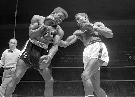 Paret (right) battles Griffith in his final fight.