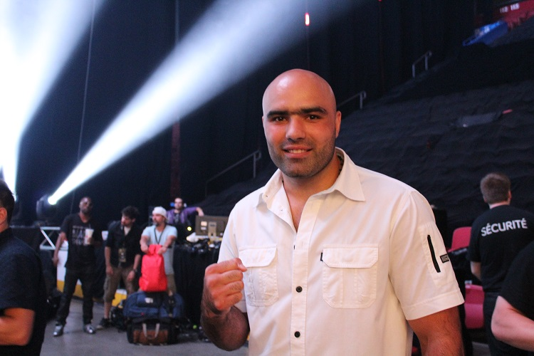 Bogdan Dinu ready to watch the main event after his knockout win.