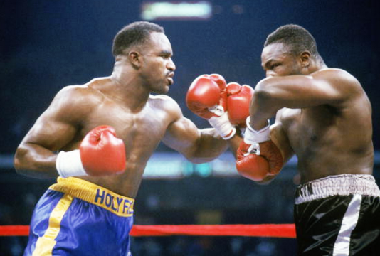 Cooper (right) had proved himself against Holyfield.