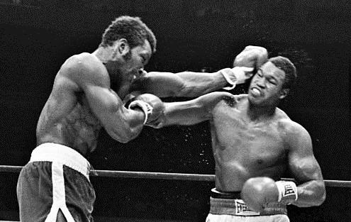 Weaver battles Holmes in 1979.