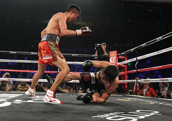 Takashi Miura is knocked down in the ninth and final round of the clash.