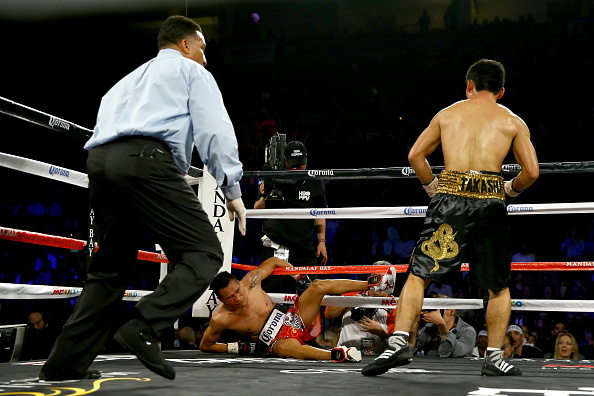 Takashi Miura knocks down Francisco Vargas in the fourth round of their WBC super featherweight title fight.
