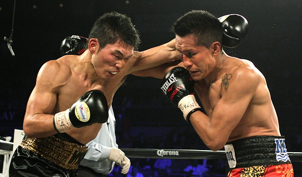 Takashi Miura of Japan (L) defends against Francisco Vargas of Mexico (R) during their WBC super featherweight title fight on November 21, 2015 at the Mandalay Bay Events Center in Las Vegas, Nevada. Vargas, knocked down in the fourth round for the first time in his career, went on dethrone Miura with a ninth round TKO. AFP PHOTO / JOHN GURZINSKI (Photo credit should read JOHN GURZINSKI/AFP/Getty Images)
