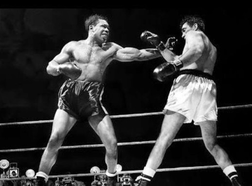 Moore finally wins a world title, defeating Joey Maxim in 1952.