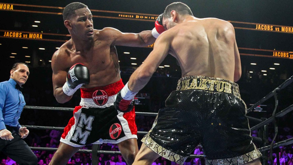 Daniel Jacobs lands a left hook to head of Sergio Mora.