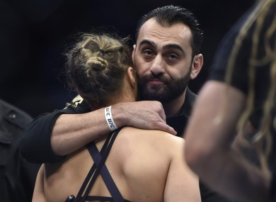Edmond consoles Rousey after her devastating defeat to Holm.
