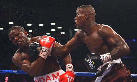 Quillin (right) winning the title from Hassan N'Dam in 2012.
