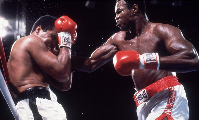 An aged Ali takes a pounding from Larry Holmes.