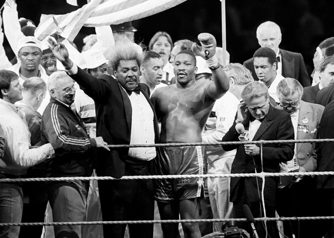 "Witherspoon celebrates his win over Frank Bruno with Don King: ""You"