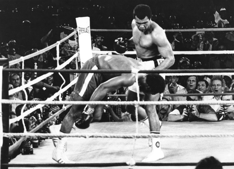 With mouths agape, George Plimpton and Norman Mailer (behind and to Ali's left) watch Foreman go down