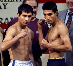 LAS VEGAS, : WBO Champion Marco Antonio Barrera of Mexico City (L) poses with WBC Champion Erik Morales of Tijuana (R) following their weigh-in 18 February 2000 in Las Vegas, NV. Morales weighed 121 pounds, Barrera weighed 121 1/2 pounds. The fighters will meet 19 february 2000 for the WBC/WBO Super Bantamweight Championship. AF PHOTO/John GURZINSKI (Photo credit should read JOHN GURZINSKI/AFP/Getty Images)