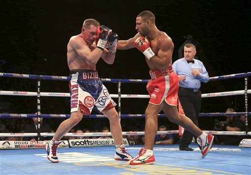 Kell Brook of Britain, right, lands a right to Kevin Bizier of Canada during the IBF World Welterweight Championship bout at Sheffield Arena, Saturday March 26, 2016. at Sheffield Arena, Sheffield, England, Saturday, March 26, 2016. (Nick Potts/PA via AP) UNITED KINGDOM OUT, NO SALES, NO ARCHIVES