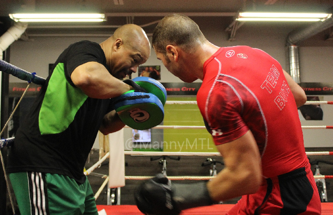 Working the mitts with Otis Grant.