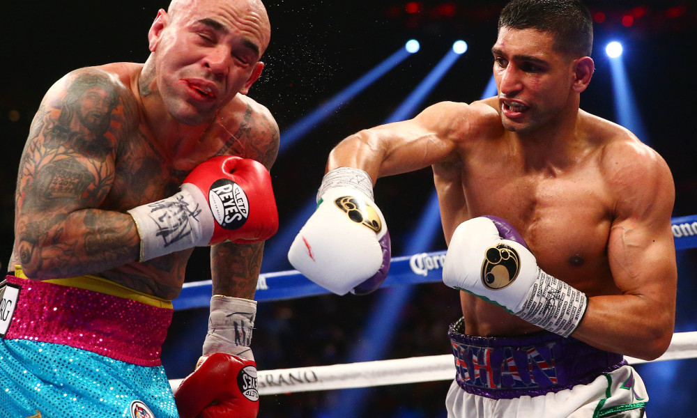 Khan defeats Collazo.