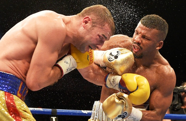 Badou Jack, right, fights Lucian Bute during a boxing match, Sunday, May 1, 2016, in Washington. The match ended in a draw. (AP Photo/Nick Wass)