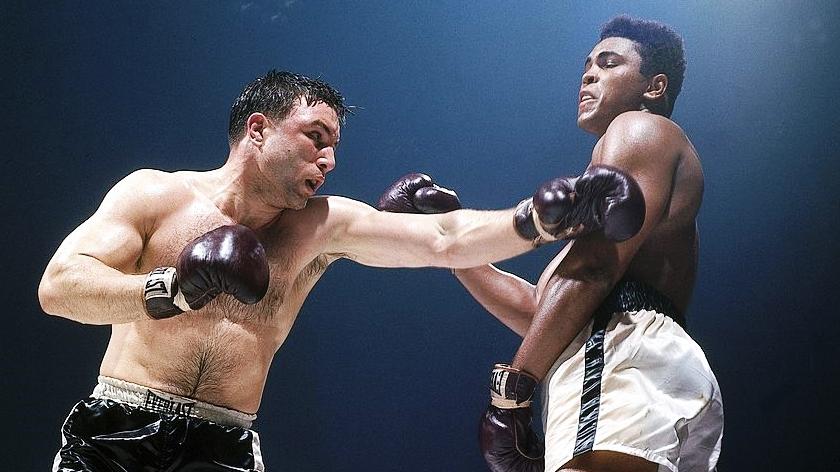 Ali slips a Chuvalo right.