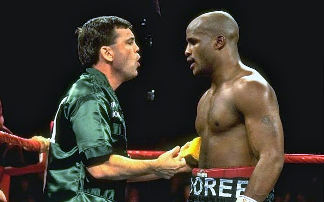 Atlas trying to motivate Michael Moorer in 1996.