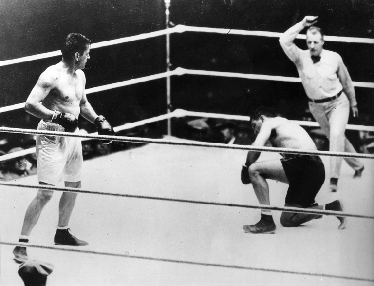 "Dempsey down in round eight in the famous ""Battle of the Long Count."""
